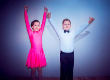 The young boy and girl posing at dance studio as winners Stock Photos