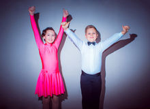 The young boy and girl posing at dance studio as winners Royalty Free Stock Photography