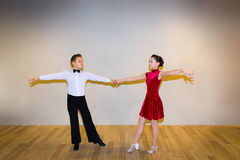 The young boy and girl posing at dance studio royalty free stock images