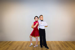 The young boy and girl posing at dance studio royalty free stock photography