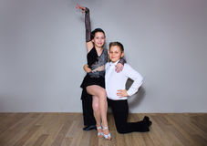 The young boy and girl posing at dance studio royalty free stock photo