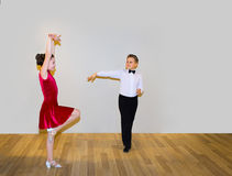 The young boy and girl posing at dance studio royalty free stock photos