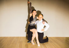 The young boy and girl posing at dance studio stock photography