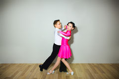 The young boy and girl posing at dance studio stock image