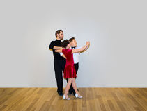 The young boy and girl posing at dance studio stock images