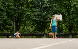 Young boy and girl practising their basketball Stock Photography