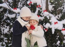 Young boy and girl with red rose Stock Photo