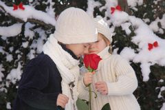 Young boy and girl with red rose Stock Photos