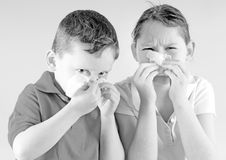 Young boy and girl sick Royalty Free Stock Image