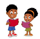 African American kids reading books. Young boy and girl standing reading an open book smiling Stock Photo