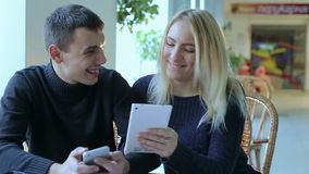 Young boy and girl with the tablet and phone stock video