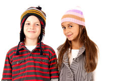 Young boy and girl wearing winter hats Stock Photos
