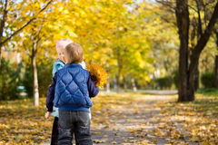 Young Boy and Girl with Yellow Autumn Leaves Stock Image