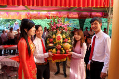 Young boy give gifts for girls in the wedding tradition Stock Images