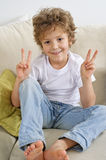 Young boy gives v sign Royalty Free Stock Photos