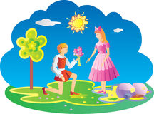 Young boy giving girl flowers. Royalty Free Stock Image