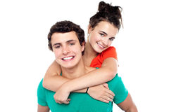 Young boy giving his girlfriend piggyback ride Royalty Free Stock Photography