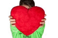 Young boy giving plush heart Stock Image