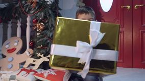 Young boy giving a present to camera stock footage