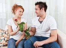 Young boy giving red rose to a beauty girl Royalty Free Stock Images