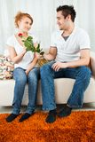 Young boy giving red rose to a beauty, young girl Stock Photography