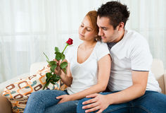 Young Boy Giving Rose To A Beauty, Young Girl Stock Photography