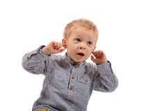 Young boy is glad. On white background royalty free stock photography