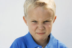Young Boy Glaring royalty free stock photos