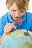 Young boy with globe Stock Photography