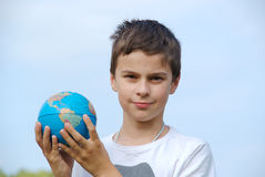 Young boy with globe in hands Royalty Free Stock Photography