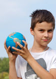 Young boy with globe in hands Royalty Free Stock Images