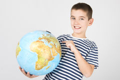 Young boy with globe Stock Photo