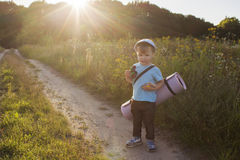 A young boy goes in search of adventure. Stock Image