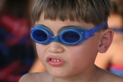 Young boy with goggles to swim Royalty Free Stock Image