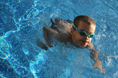 Young boy with gogles in pool Royalty Free Stock Photo