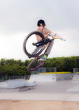 Young boy going airborne with bike Royalty Free Stock Images