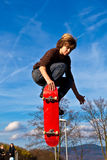 Young boy going airborne with his skateboard. Boy going airborne with his skateboard royalty free stock photography