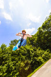 Young boy going airborne with a scooter Royalty Free Stock Photography