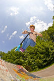 Young Boy Going Airborne With A Scooter Stock Image