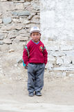Young boy going home from school after lessons at the local school at Lamayuru Gompa, Ladakh, North India Stock Photography