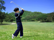 Young boy golf swing Royalty Free Stock Image