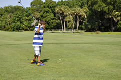 Young boy golfing. On a beautiful day.  The golf course is Sea Piines Resort on Hilton Head Island in South Carolina Stock Photography
