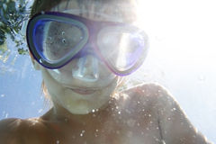 Young boy in googles underwater Royalty Free Stock Photos
