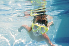 Young boy in googles underwater Stock Photo