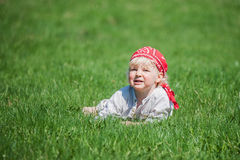 Young boy on the grass Royalty Free Stock Images