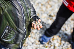 Young boy with gravels in hand Royalty Free Stock Images