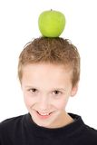Young boy with a green apple on the head Royalty Free Stock Image
