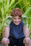 Young boy with green gloves royalty free stock images