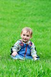 Young boy in green grass Stock Photo