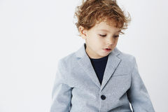 Young boy on grey background Royalty Free Stock Photo